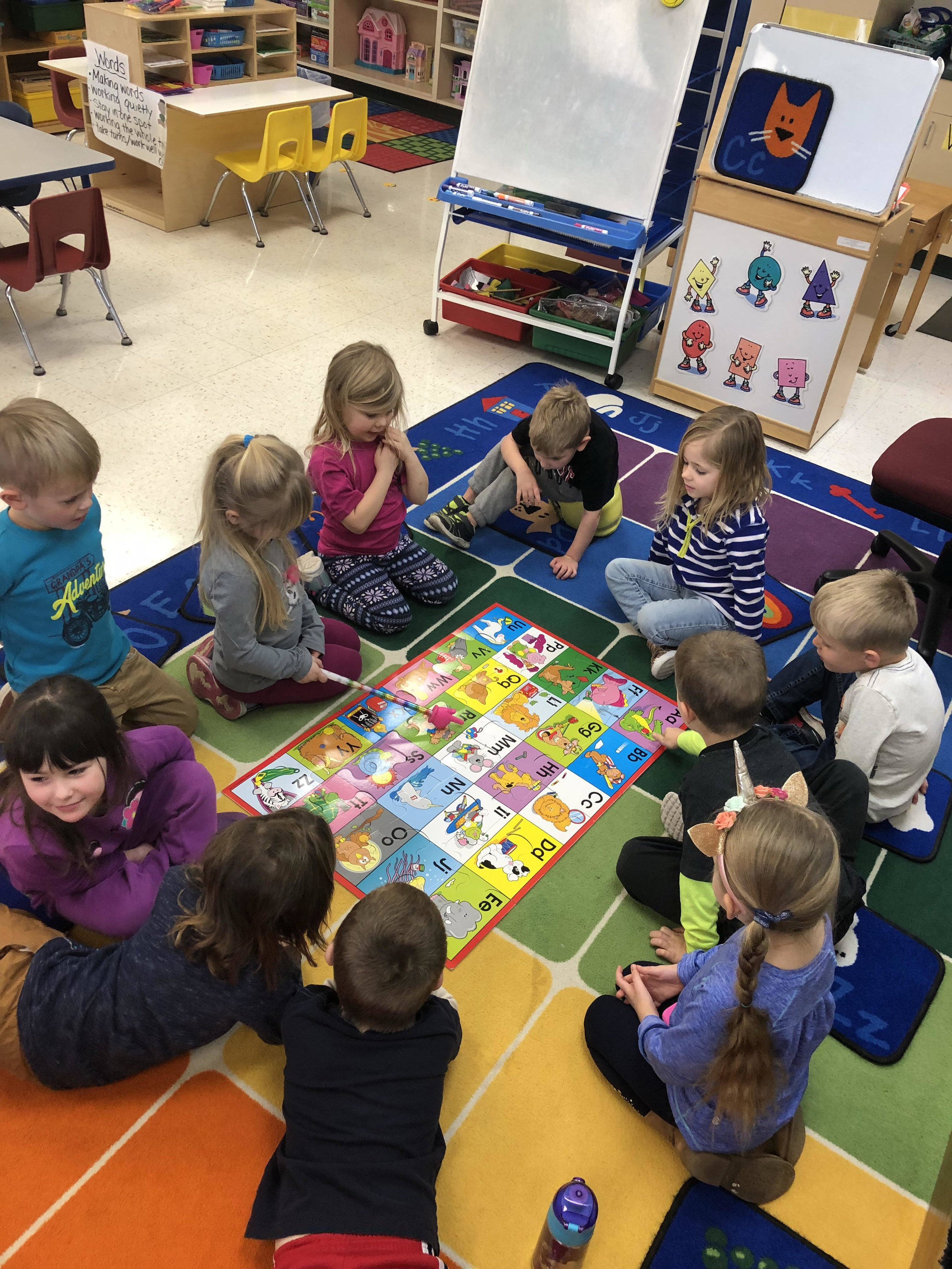 working together on a floor puzzle