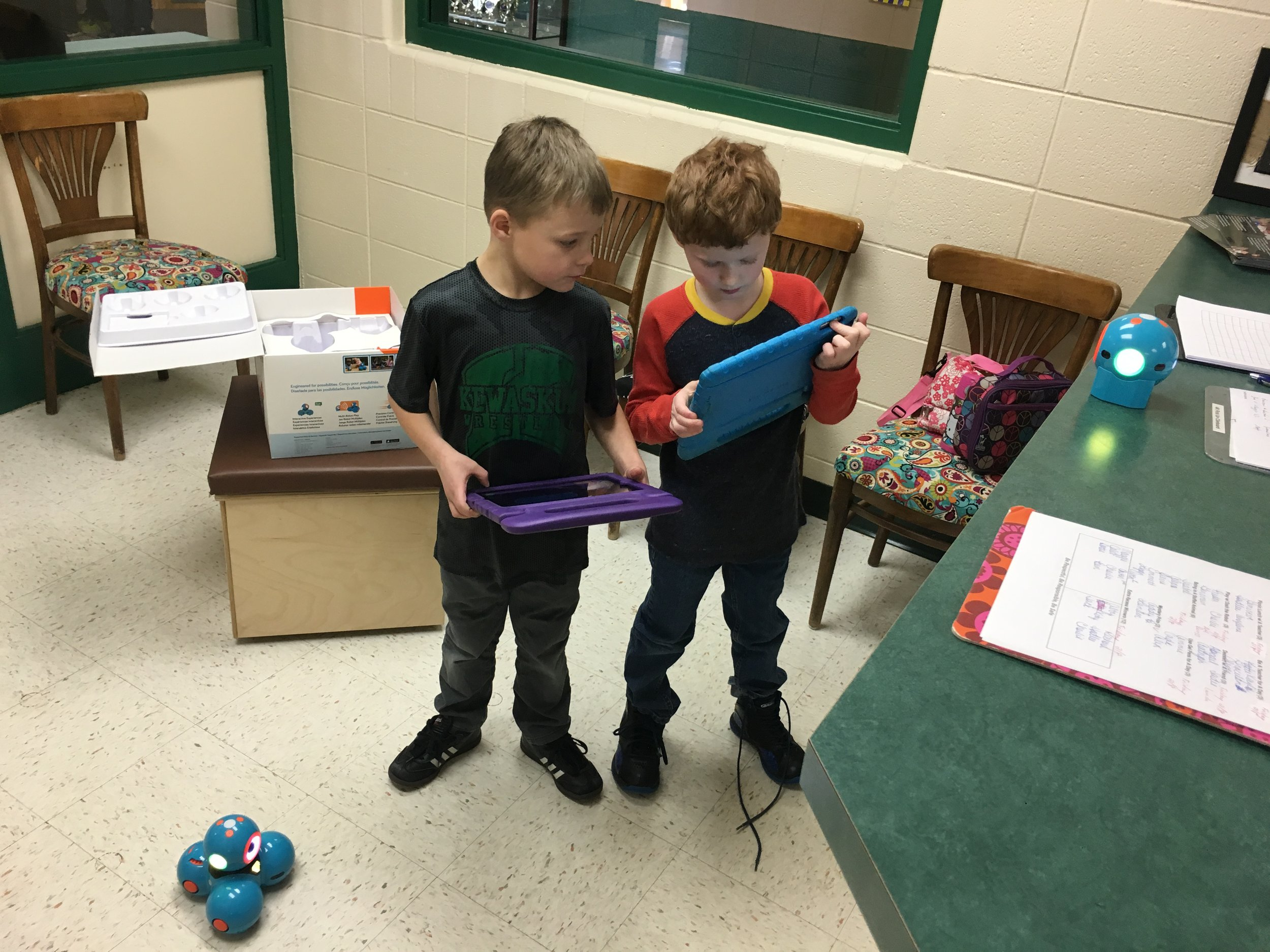 """PBIS """"Play with the Robots Winners"""" enjoying collaborating on how to solve a challenge!"""