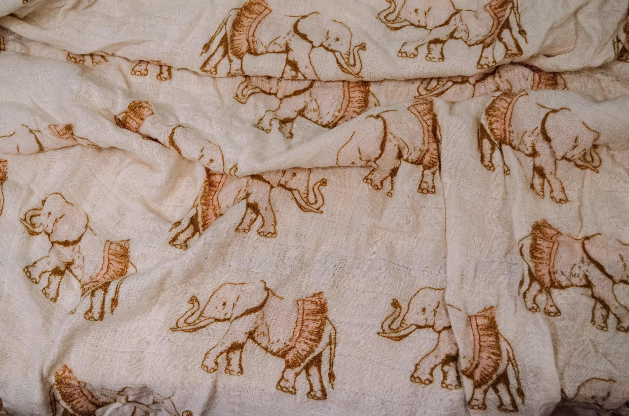 """This is my favorite of Holland's infant swaddles. - I love the pattern, but for some reason, I also associate it with the postpartum depression I experienced. It's also described in the opening lyrics of """"Elephants."""