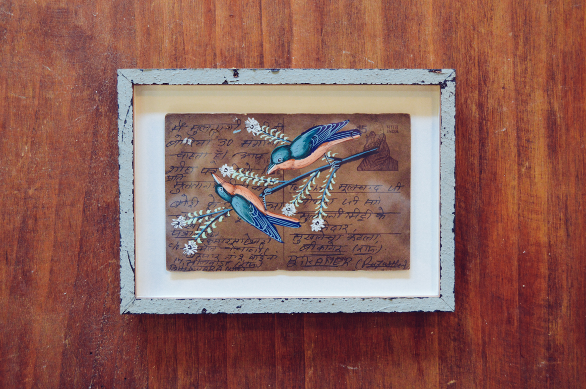 Unknown artist from India   |   Postcards framed in old fence paling.