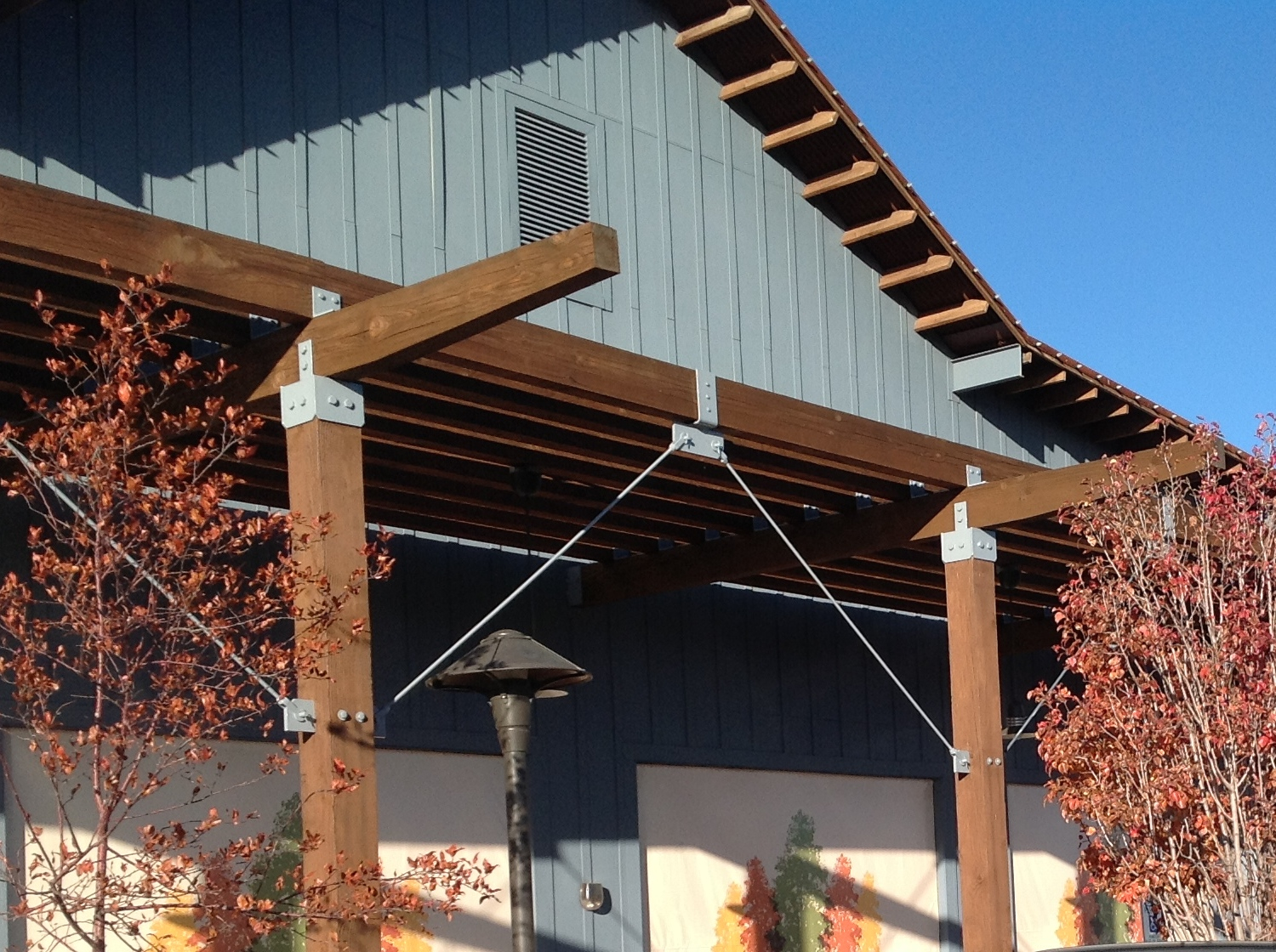 Wood re-staining and detailed bolt/bracket painting with an exterior rust inhibiting product