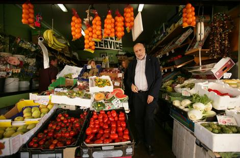 Believer in local food traditions … Carlo Petrini, founder of the Slow Food Movement, visiting a Haberfield fruit shop owned by Francesco Bonfante.  Photo:  Marco del Grande