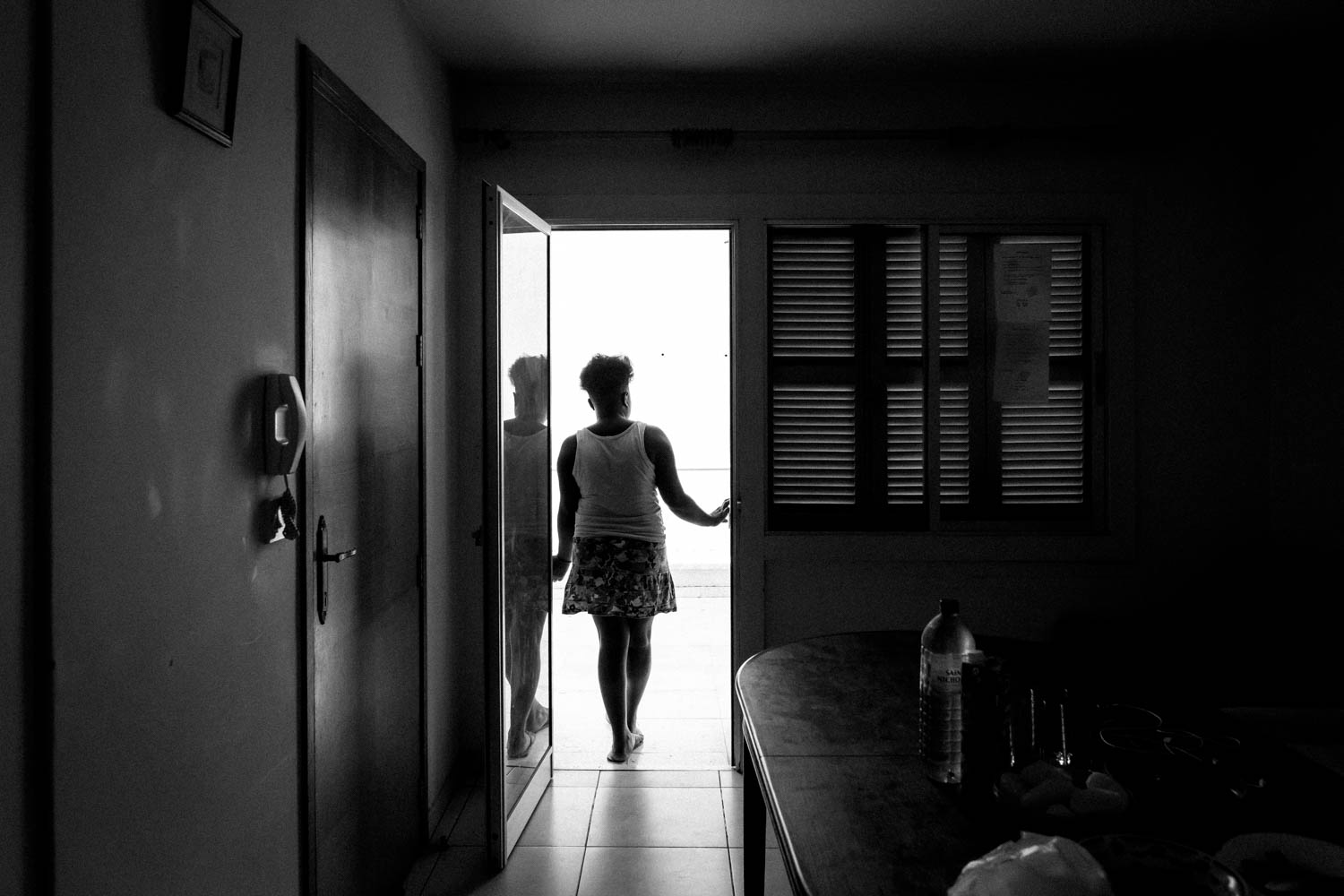 Cyprus, 2015. Laura (name changed), a young girl from Central Africa is looking out onto her balcony. The transitional housing for survivors of trafficking offers long term accommodation for women and men who need a place to recover and heal until they are able to integrate back into society.