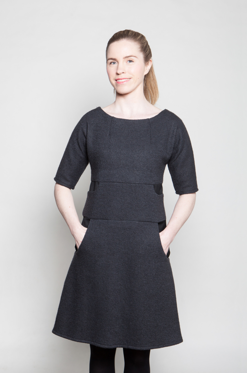 Sofie dress  Sofie dress is made of soft wool mix material. Dress with a zip on a back has all together eight pockets and lining on a hem.