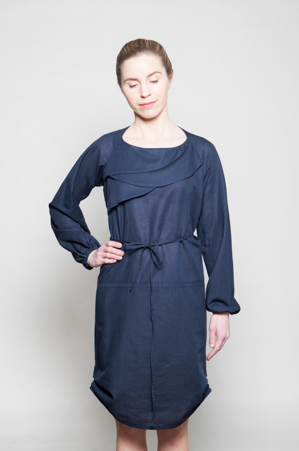 Uni dressUni dress is made of 100% cotton. Long sleeves have elastic on wrists. The dress can be gathered together on hips with thin fabric belt or worn straight down. -