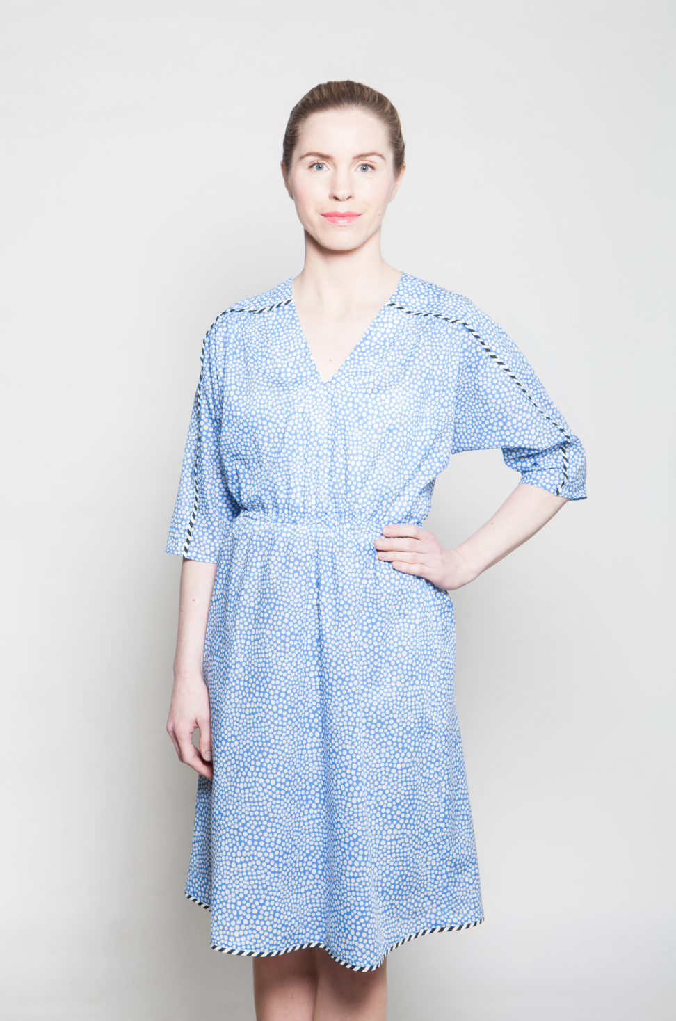Irina dress (blue) is made of light cotton mixed material. Dress has a elastic cord on a waist and tripy trimmins on sleeves and on a hem.