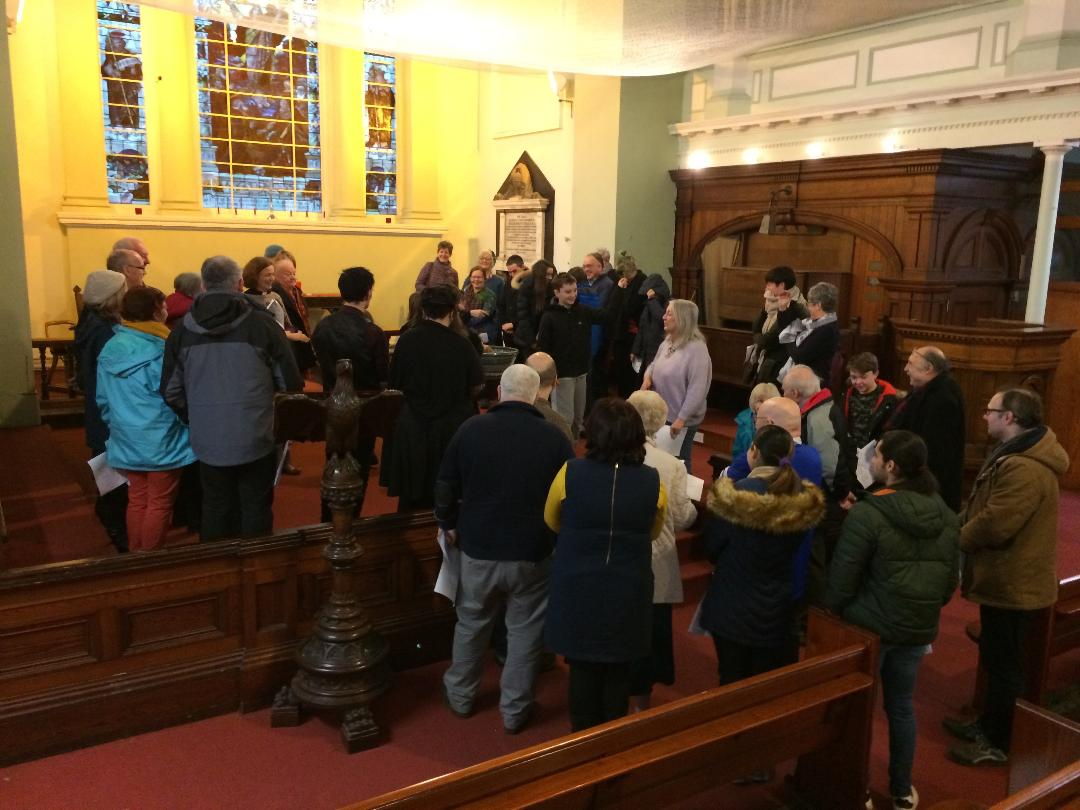Gathering around the sanctuary for an Advent celebration