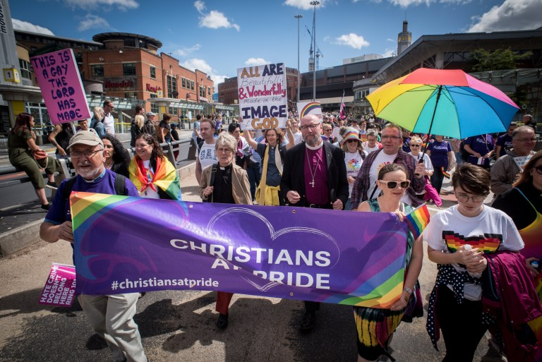 Chair of the Liverpool Methodist District Sheryl Anderson and Bishop of Liverpool Paul Bayes march with the Liverpool Christians at Pride group organised by Open Table Liverpool, Saturday 28th July 2018.
