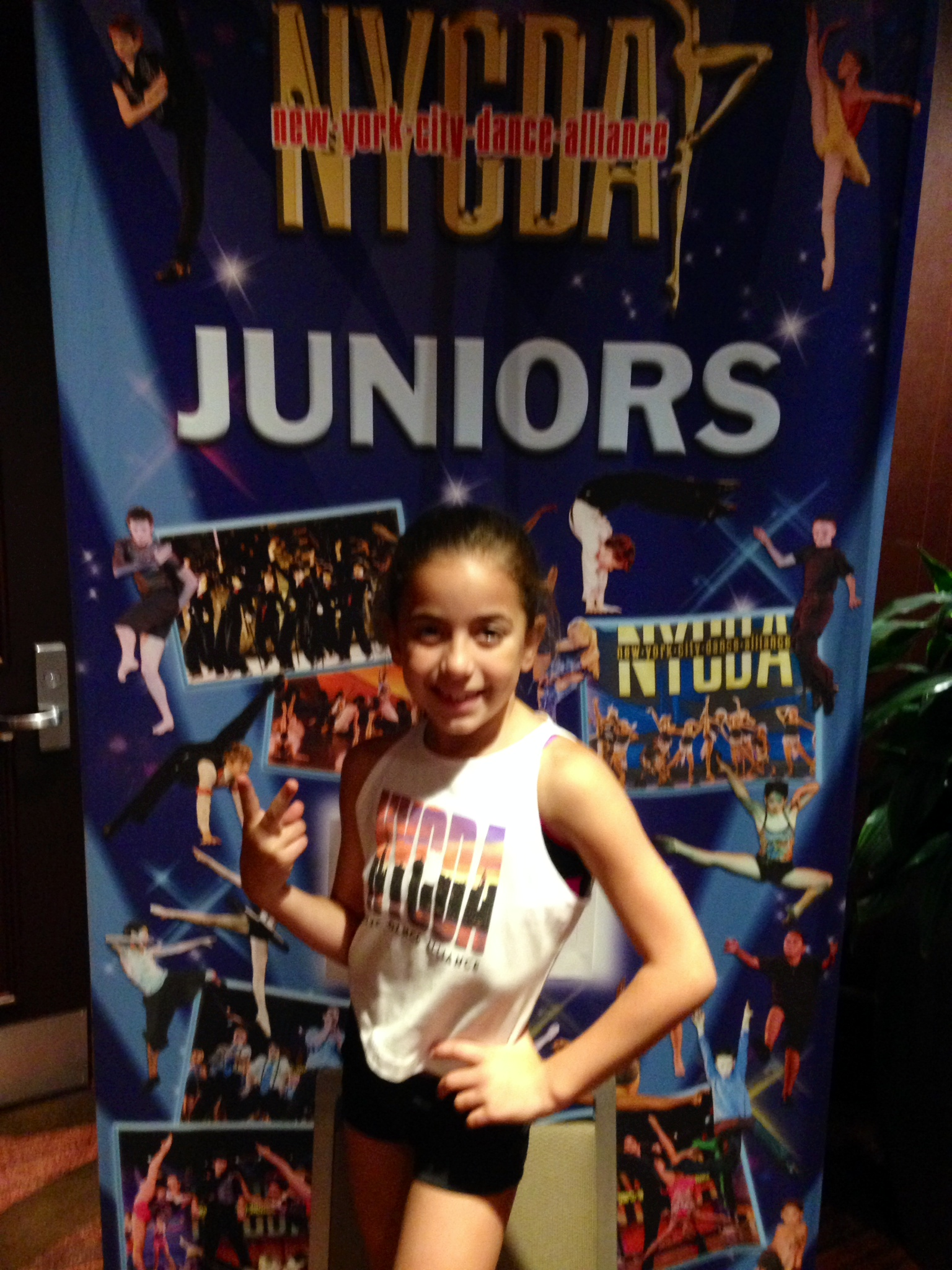 GiaNina-in-front-of-NYCDA-Nationals-Juniors-sign.jpg
