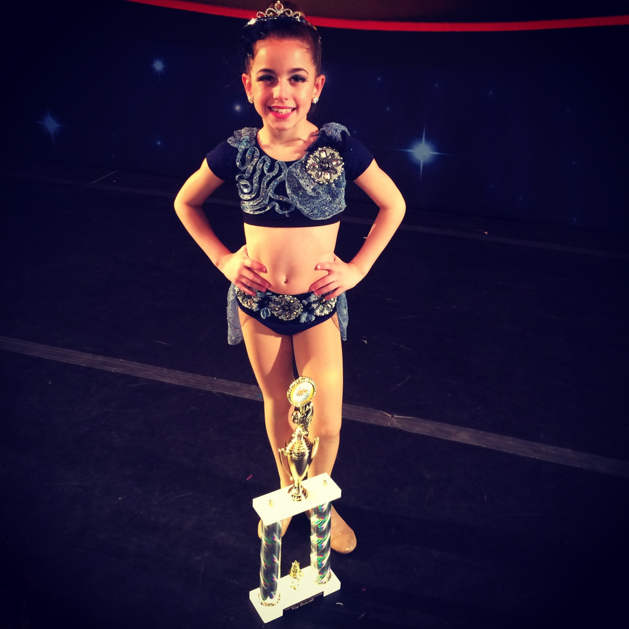 GiaNina-standing-with-her-2014-Miss-Petitte-NDS-trophy-2048x2048.jpeg