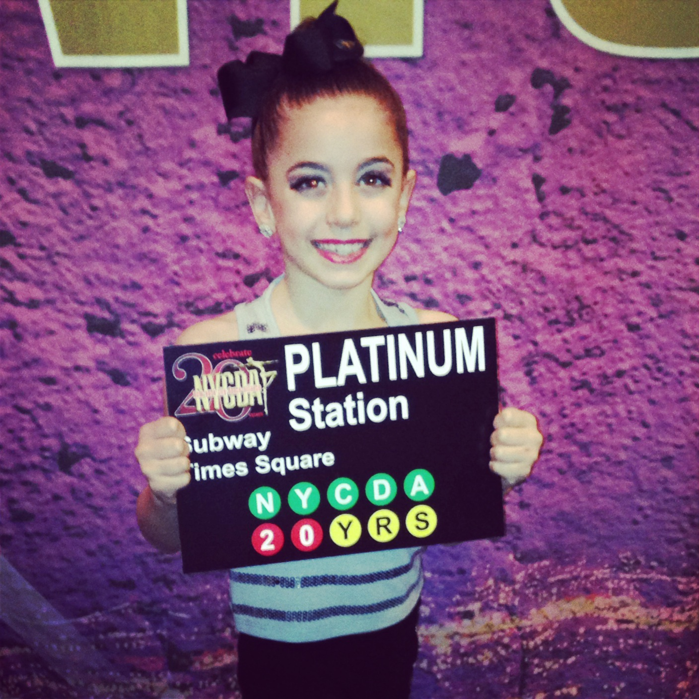 GiaNina-with-her-platinum-award-for-her-solo-at-NYCDA-regional-2014.jpg