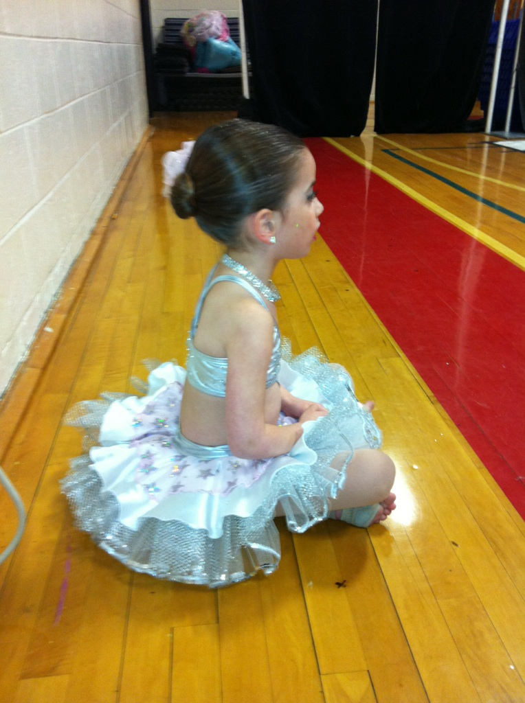 GiaNina sitting backstage watching a dance in her cyberbaby costume.jpg