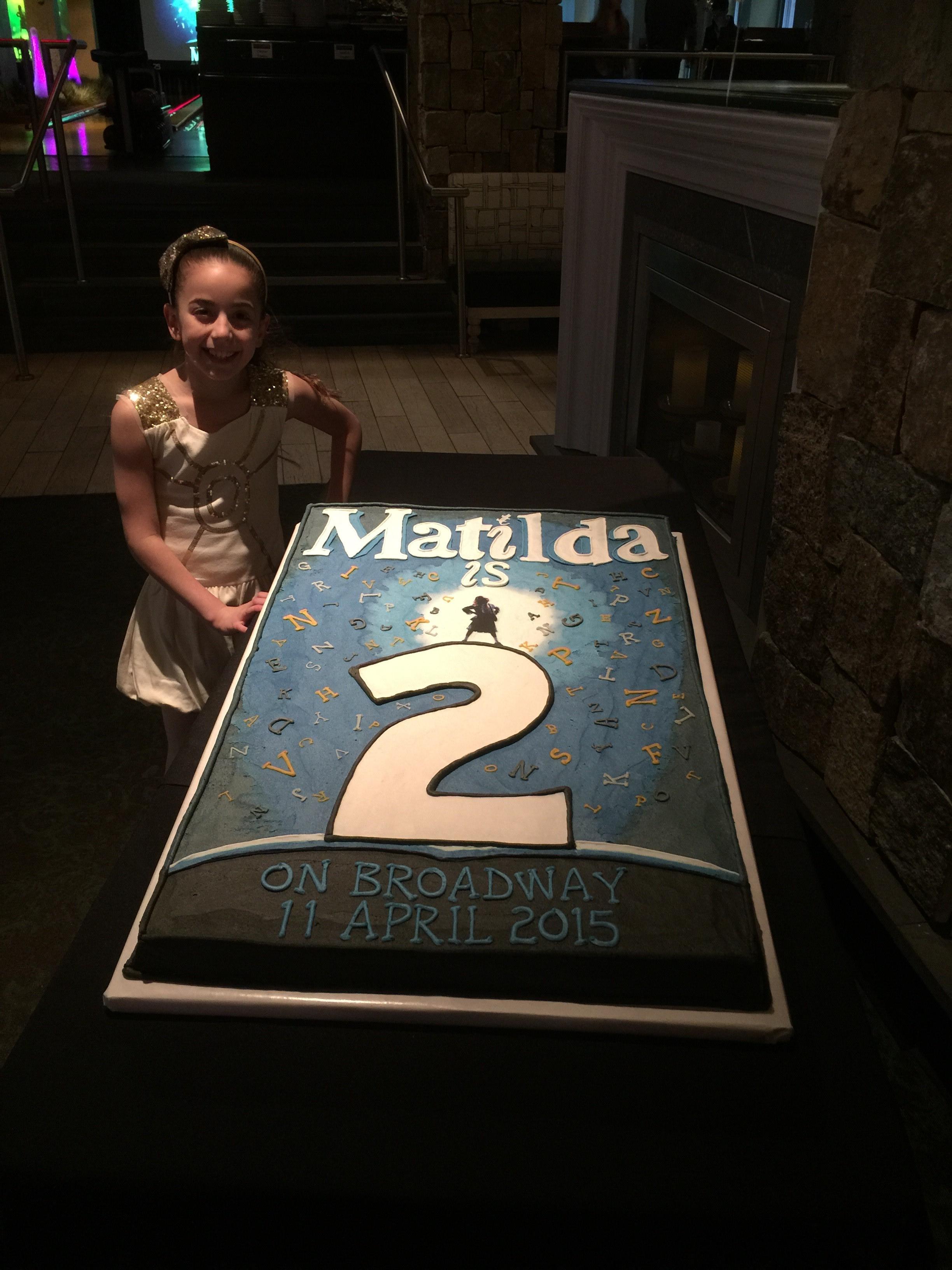 GiaNina next to Matilda cake.jpg