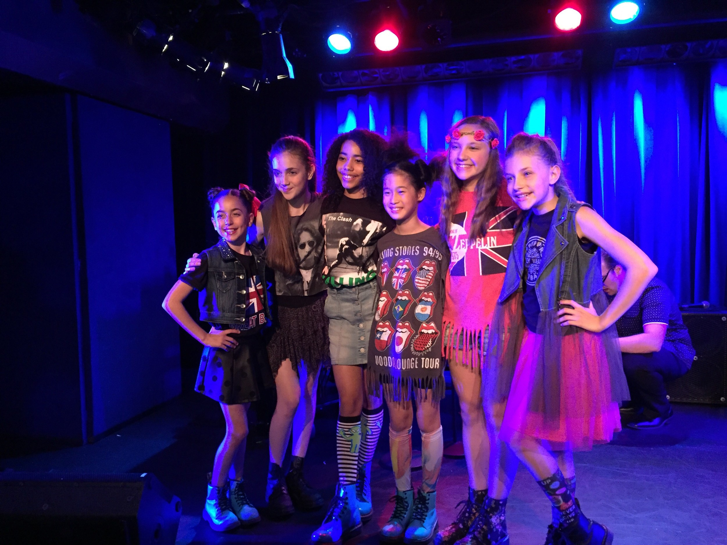GiaNina and her Matilda sisters on stage at Brits benefit.jpg