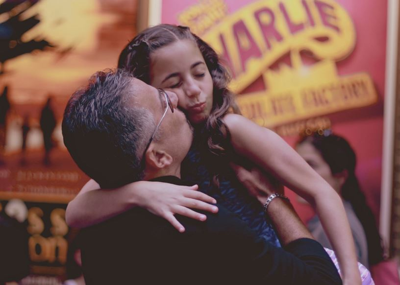 Daddy hugging and kissing GiaNina before she goes into her last show.JPG