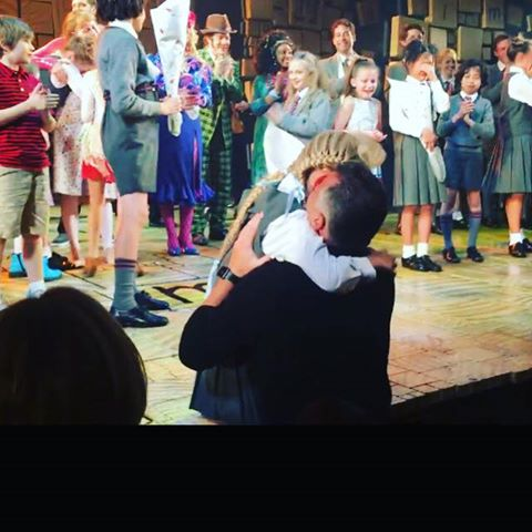 GiaNina hugging Daddy after taking her final bow at Matilda.jpg