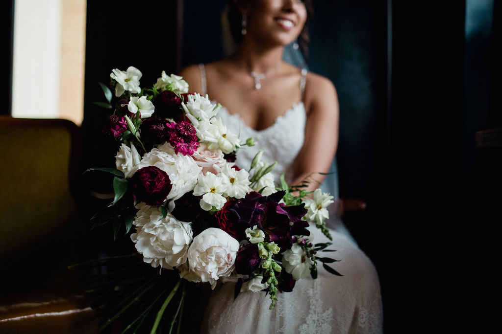 52 pristine floral flowers bouquet design bride moody dramatic dark ceremony rachel desjardins studio wedding story telling moments photography kellermans event center minnesota emotional.jpg