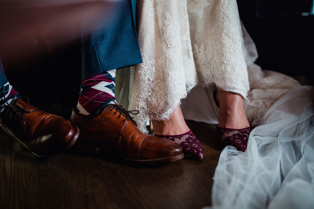 55 signature rachel photo dark moody feet shoot bridal moments close up ceremony rachel desjardins studio wedding story telling moments photography kellermans event center minnesota emotional.jpg