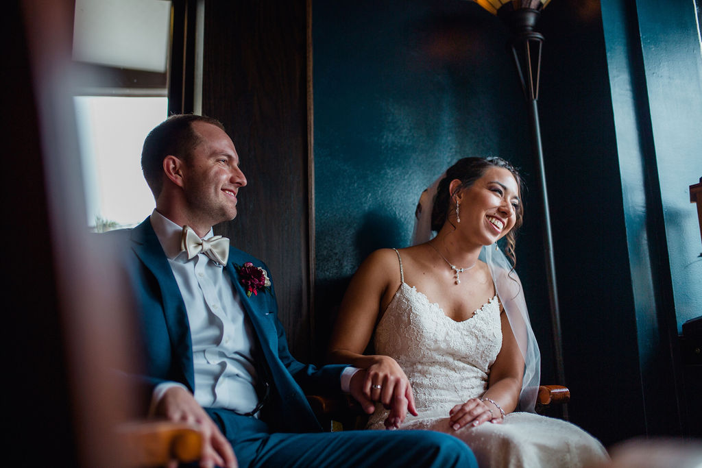 56 laughing smiling happy bride groom married dark moody dramatic ceremony rachel desjardins studio wedding story telling moments photography kellermans event center minnesota emotional.jpg