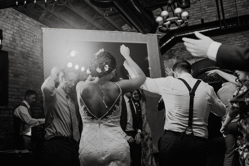 65 dancefloor fun energetic dance ceremony rachel desjardins studio wedding story telling moments photography kellermans event center minnesota emotional.jpg