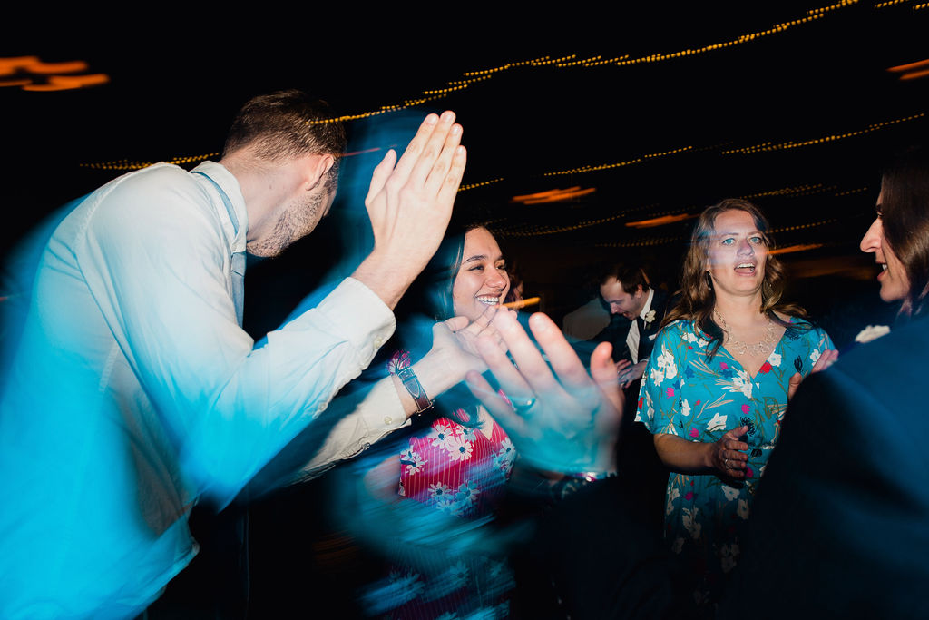 68 dancefloor fun energetic dance ceremony rachel desjardins studio wedding story telling moments photography kellermans event center minnesota emotional.jpg