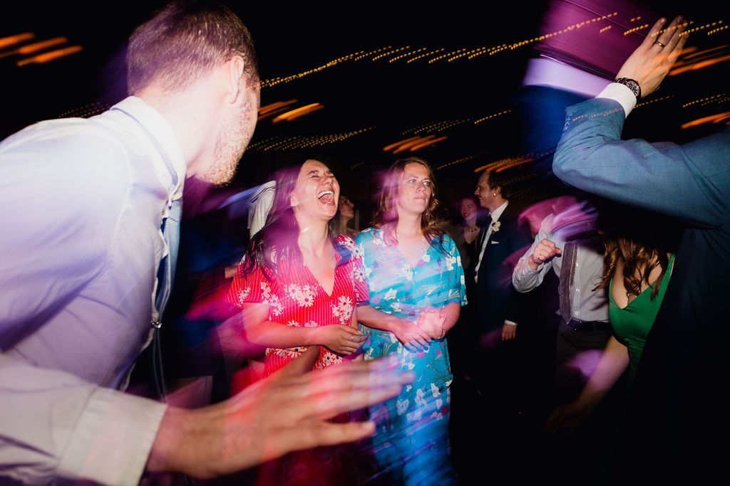 71 dancefloor fun energetic dance ceremony rachel desjardins studio wedding story telling moments photography kellermans event center minnesota emotional.jpg