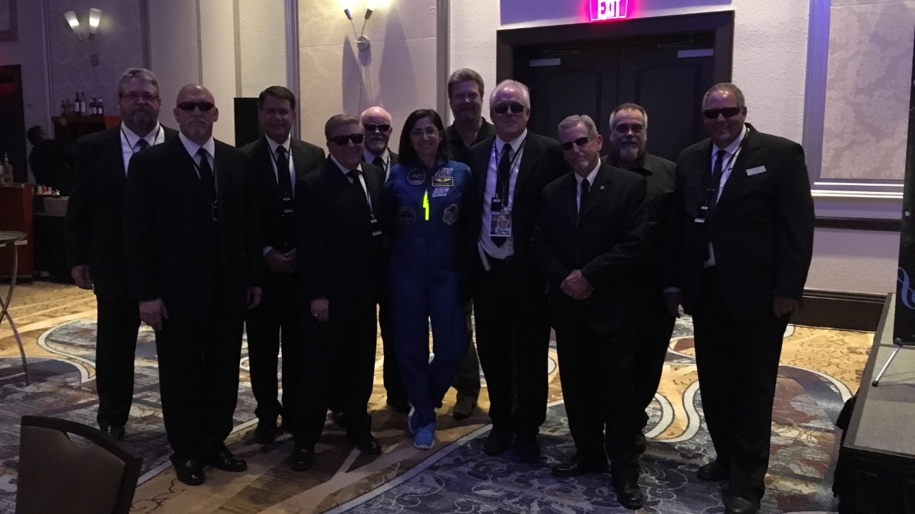 The Men in Black with a real Outer Space traveler. She told us she never saw any aliens....obviously she is part of the government cover-up.