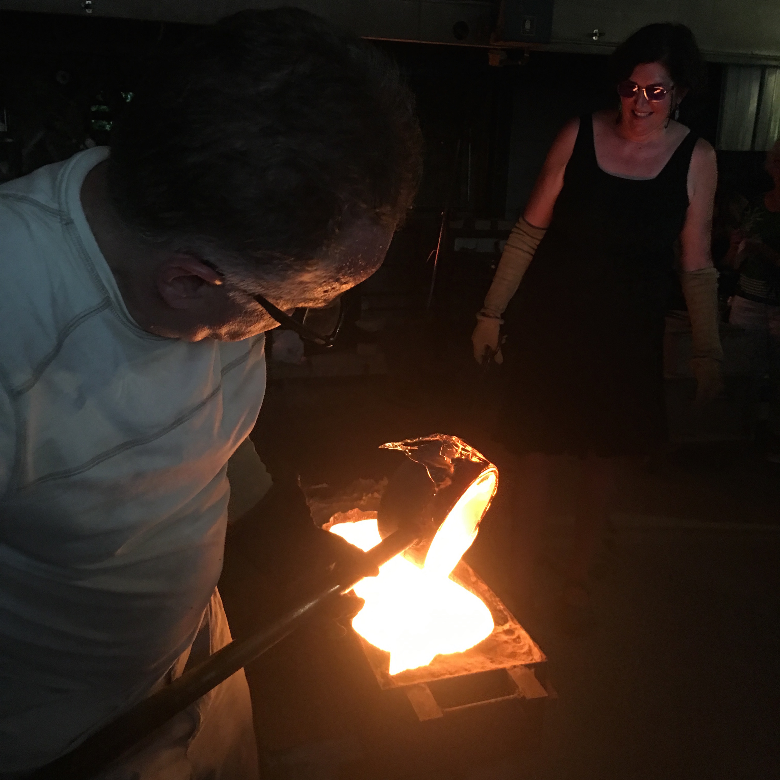 Jeremy pouring molten glass into the dragon mold. Photo by Suzanne Rose