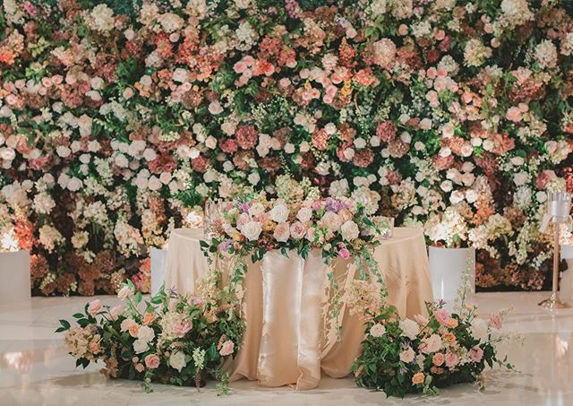 Nothing like a stunning cascade of flowers to make a statement for wedding guests! | | #laureleventsla | Photographer @dmitry_shumanev | Flowers @egfloraldesign |Rentals @Theonicollection @palacepartyrental |linens@latavola | Lighting @ambereventprod | Stationery @creativeworksdesigns |  Video @renezadoriphotography | Hair @helenk.hairstylist | Makeup @beautybychloe__ | DJ @djsevag | Venue @langhampasadena