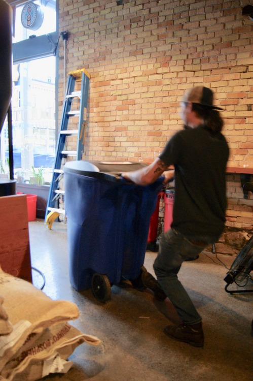 Eric hard at work, moving bins heaping with roasted coffee beans!