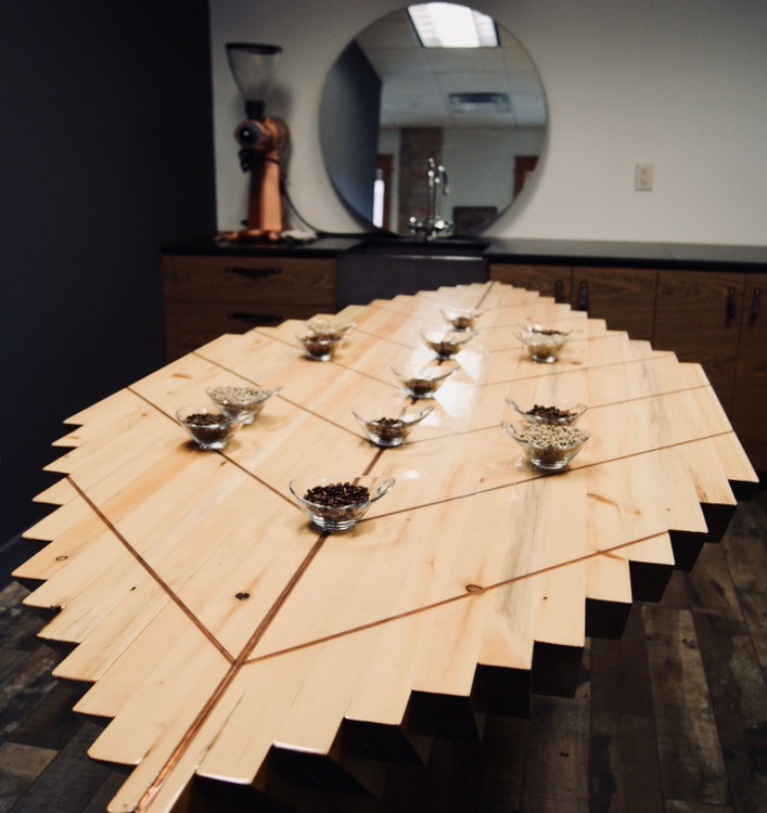 This cupping table, in the shape of a coffee leaf and stained with coffee, was handcrafted by a friend designed specifically for Duluth Coffee Company for the purpose of tasting coffee.