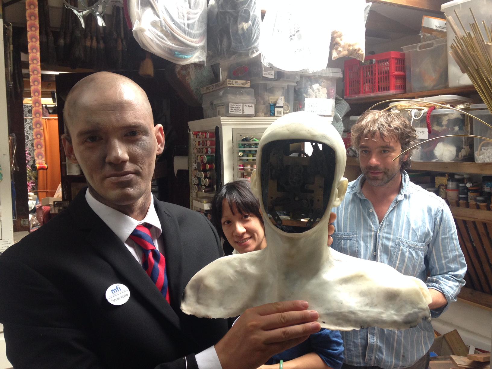 (Left to right, inside Natasha Lawes' studio) Reuben Hollebon, Natasha Lawes, Reuben Hollebon's robot, James Slater