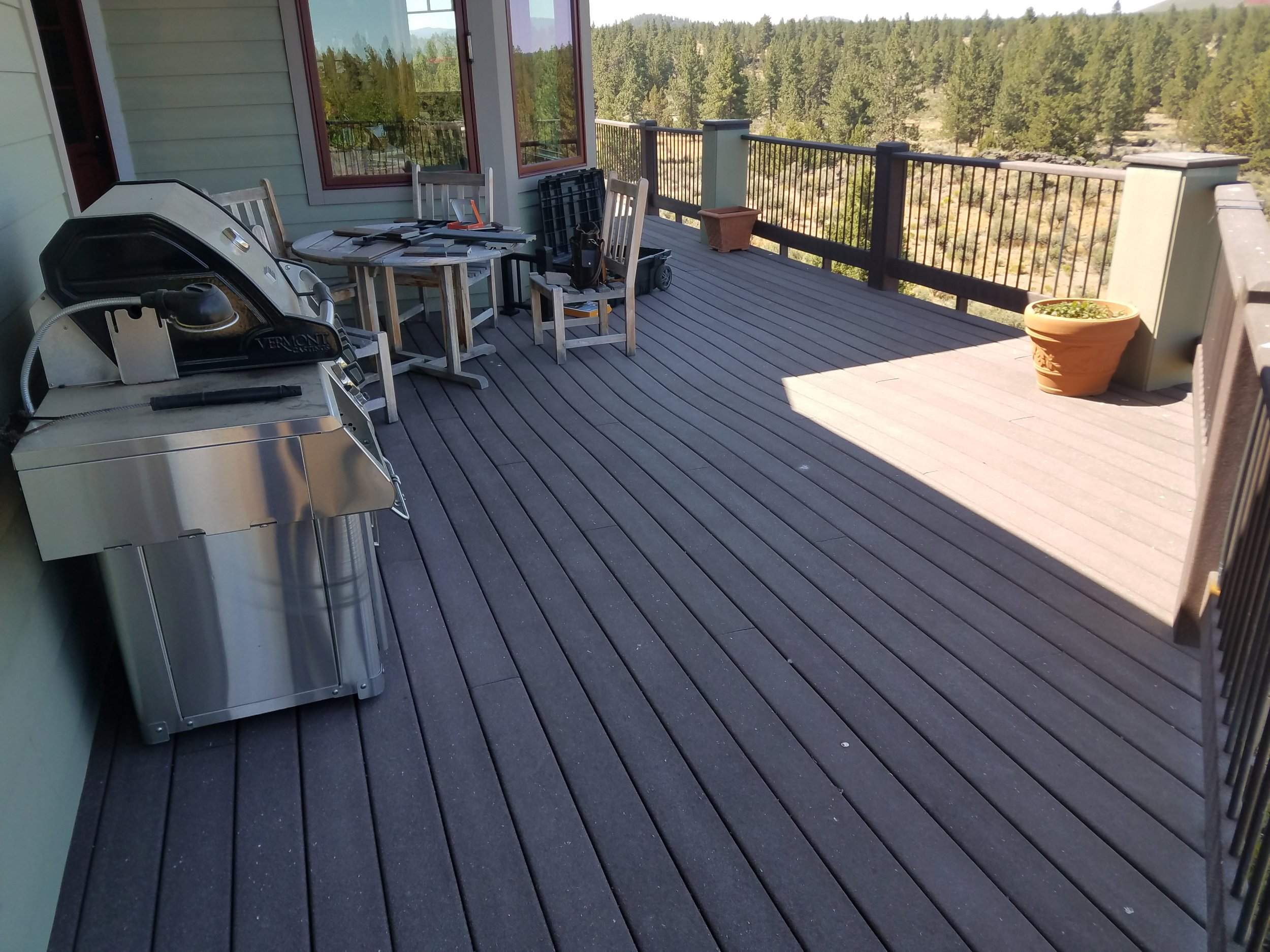 Original deck with first generation non-capped  Trex decking and overspanned joists