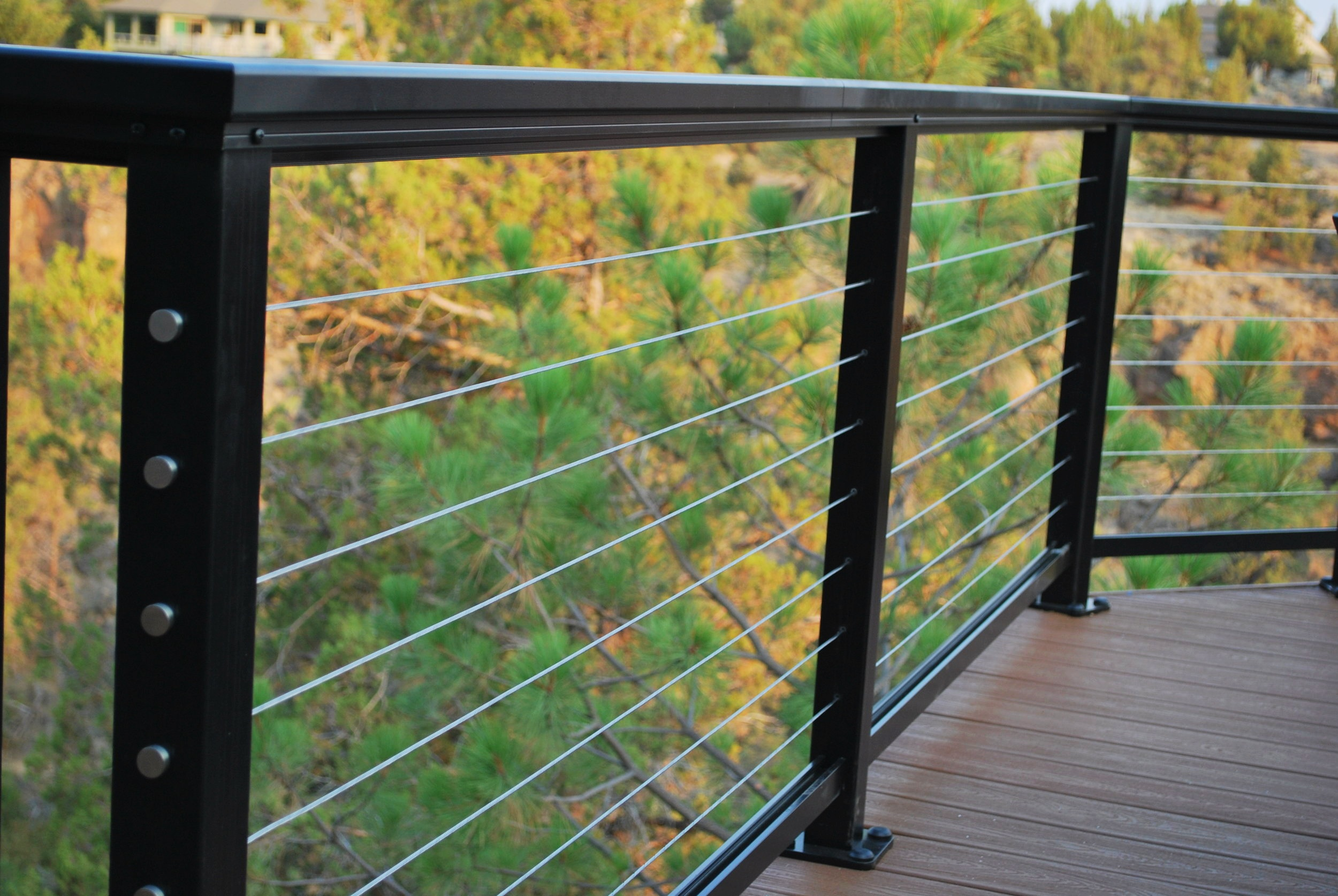 Railing - If your project will include railings there are a plethora of options available. Metal, aluminum and composite railing frames are the industry standard and will offer one or more of the (3) most common infill styles: Picket, cable and/or glass. The color options available, railing top-cap profile options, post thickness and pricing will vary between styles and manufacturers.