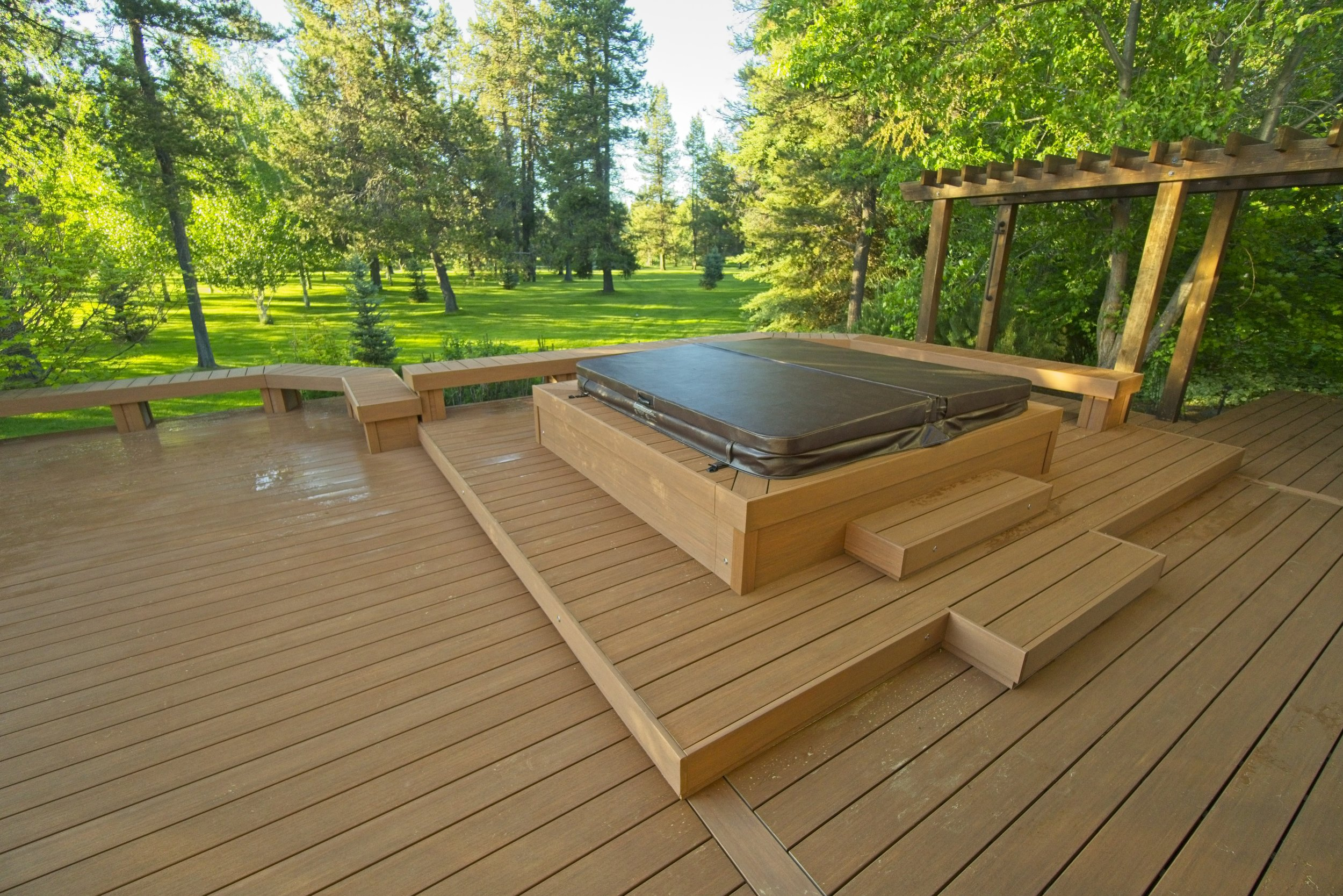 Fascia - Identified as the horizontal boards that are installed on the outside edges of your deck, its benches, and other vertical deck surfaces, the fascia will usually be installed using the same material as the deck's surface or using the same material as was used for the house's trim. When the fascia material matches that of the house trim, the deck tends to appear more 'built in'; like it was part of the original architecture. When the fascia matches the decking, the lack of future maintenance is celebrated.