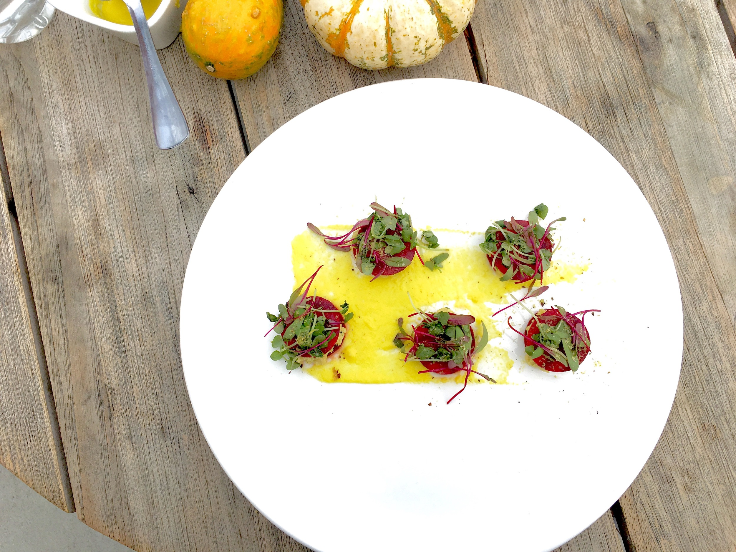 Red beet ravioli // cashew chew, pisatchios, bell pepper puree
