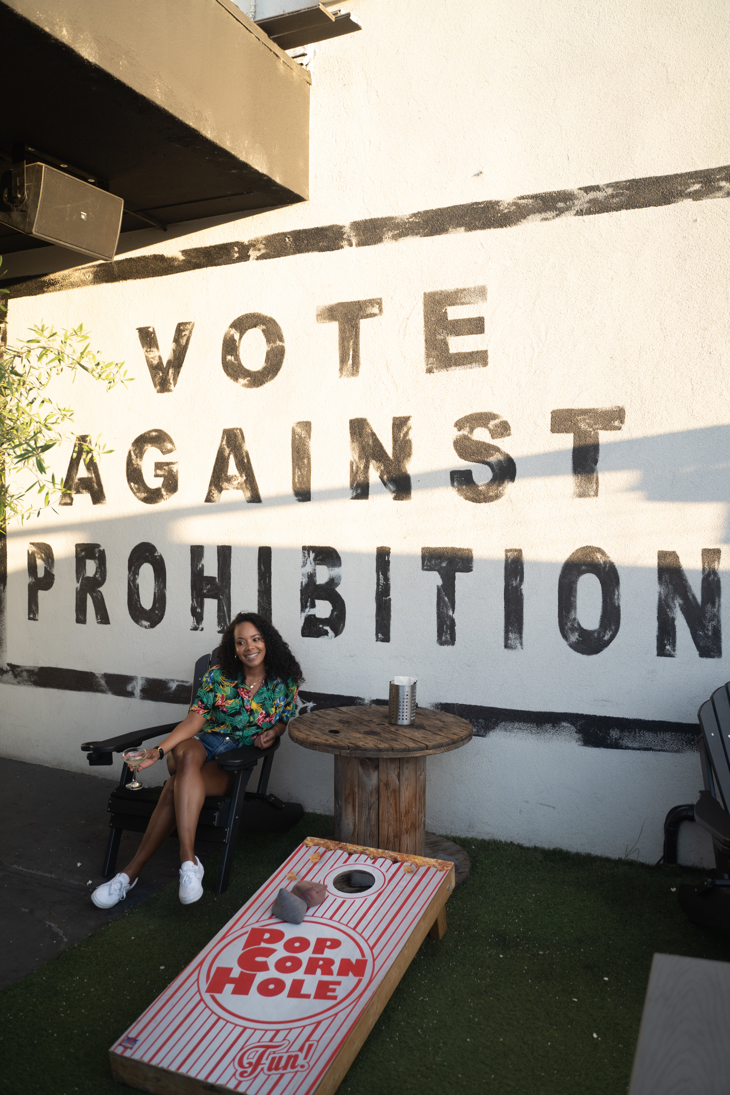"""Tiffy posing in front of """"Vote against Prohibition"""" Sign."""