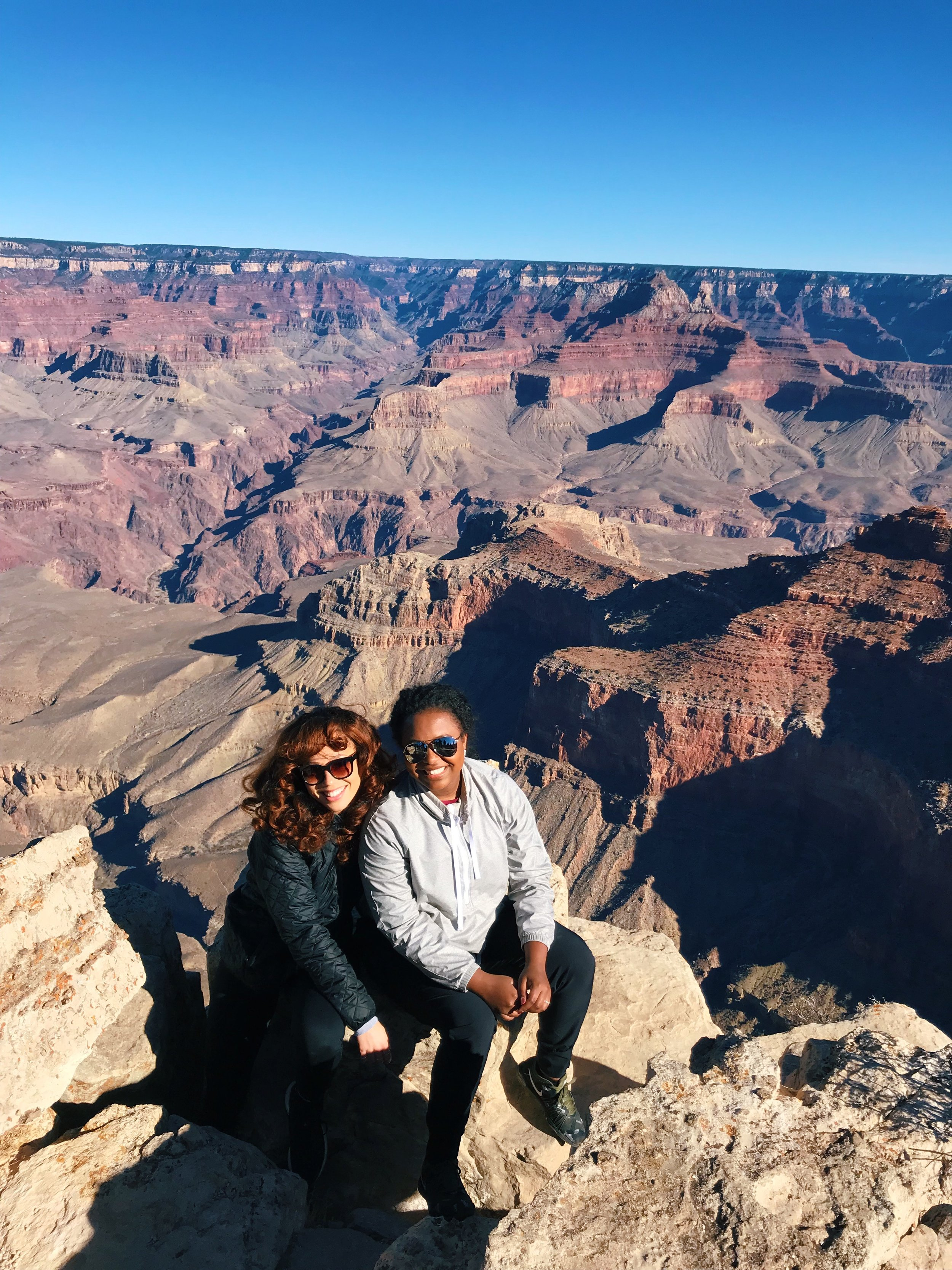 My dear friend Tiffany and I beyond the railing at the South Rim of the Grand Canyon
