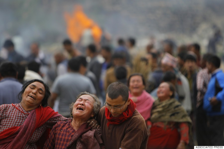 Family members break down during the cremation of earthquake victims in Bhaktapur near Kathmandu, April 26, 2015. (AP Photo/Niranjan Shrestha)