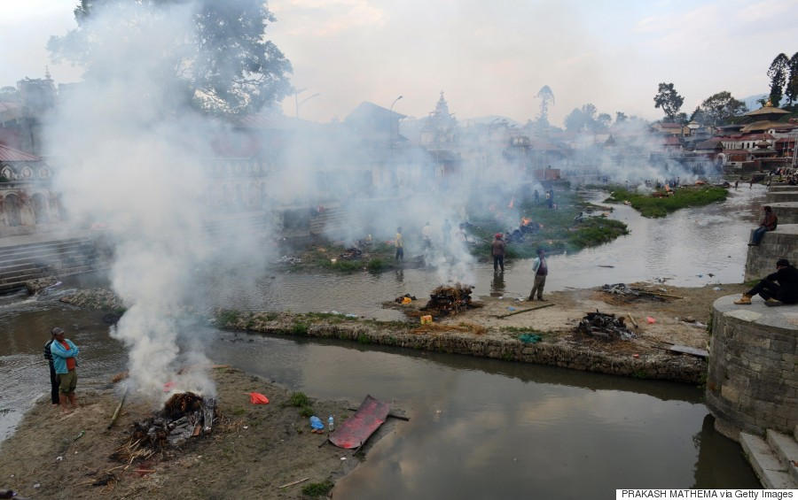 People burn the bodies of earthquake victims at a mass cremation at Pashupatinath in Kathmandu on April 26, 2015. (PRAKASH MATHEMA/AFP/Getty Images)