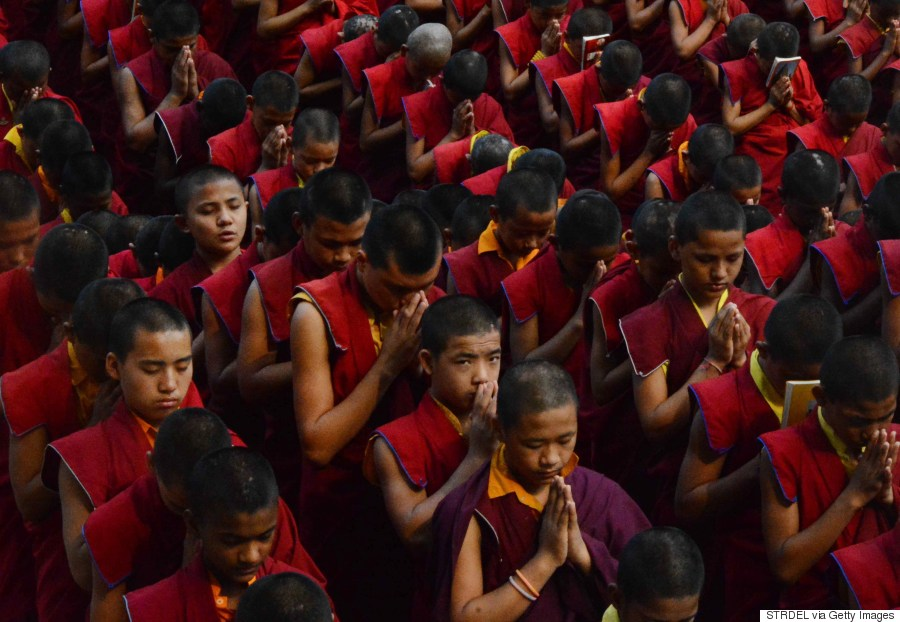 Nepalese novice Buddhist monks offer prayers for earthquake victims at the Bodhgaya Mahabodhi Temple in the Indian town of Bodhgaya on April 26, 2015. (STRDEL/AFP/Getty Images)