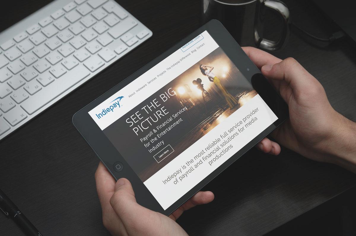 Indiepay-iPad-in-hands---Homepage.jpg