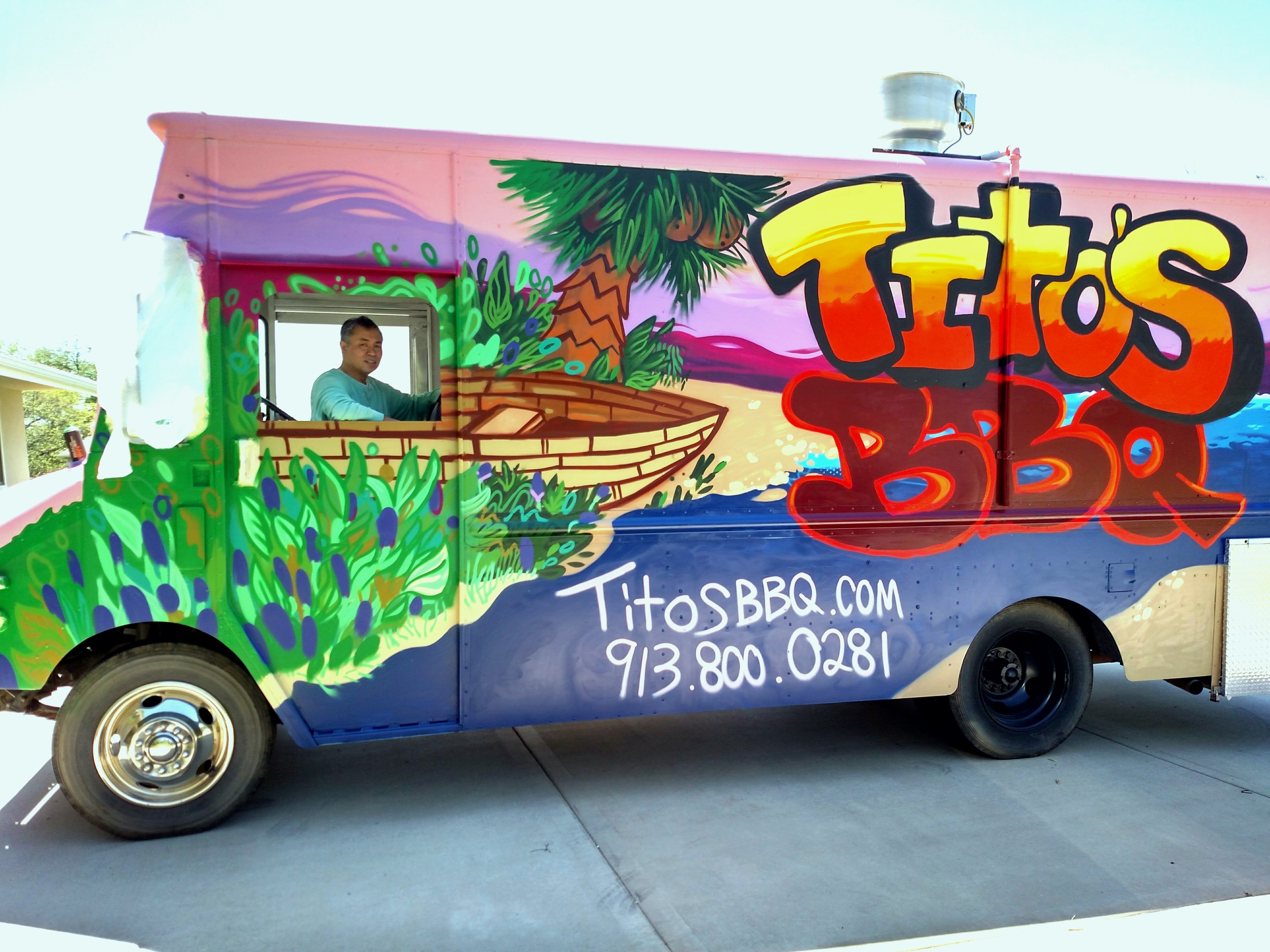 Tito hanging out in his newly painted BBQ food truck