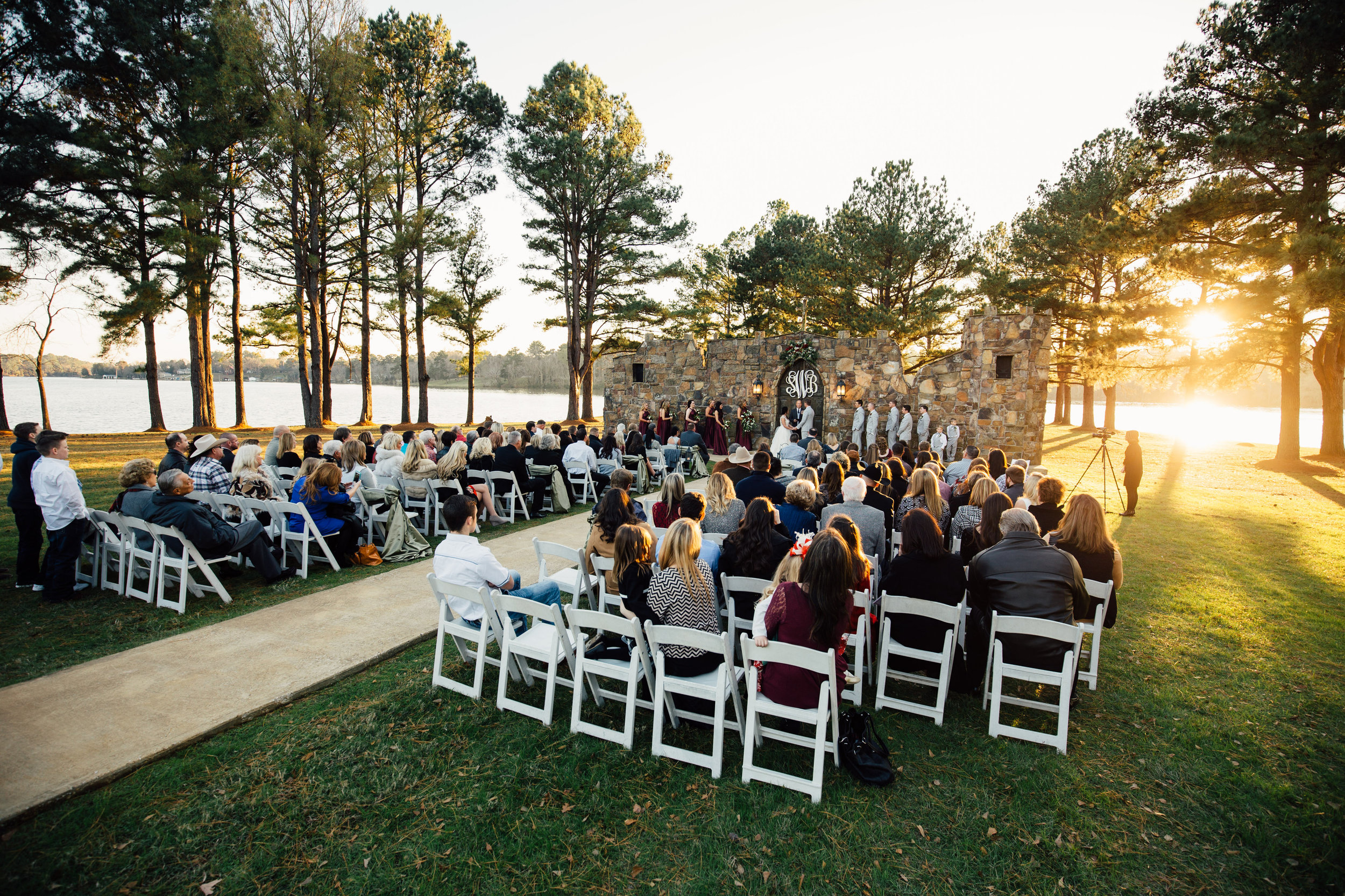 Notice how the sun sets in front of the guests.Location - Castle on the Lake