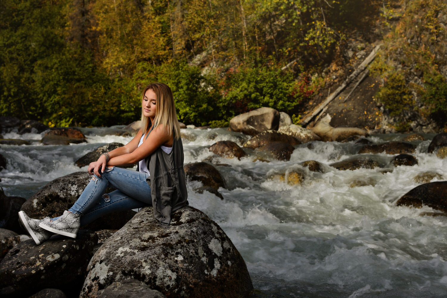 Senior portrait on the rocks by the river