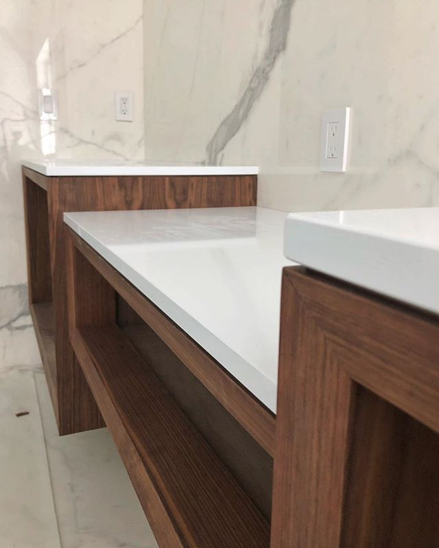 Bevels, 1/8 Reveals, Walnut and Quartz for the win 🔥 As always the tops from @minnesotatileandstone are 👌 #integrity_construction_inc #contractor #builder #remodeler #renovator #bathroom #floatingvanity #walnutvanity #quartzcountertops #keepcraftalive #minnesota #twincities