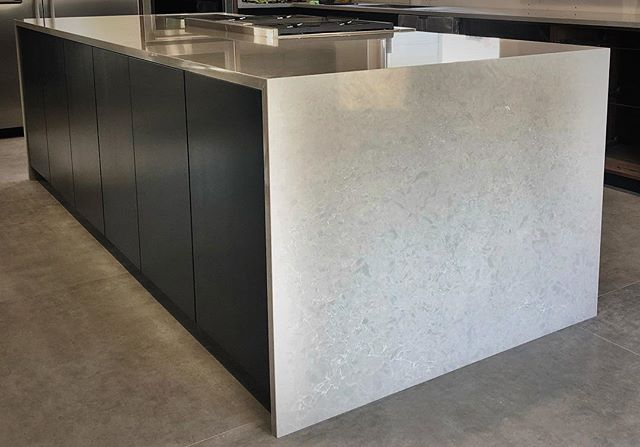 "At almost 49"" wide and 10' long, this islands a beast ! As always, 🔥 from @minnesotatileandstone #integrity_construction_inc #contractor #builder #remodeler #renovator #kitchen #kitchenisland #kitchendesign #moderndesign #blackcabinets #walnutcabinets #quartzcountertops #waterfallcountertop #wolfappliances #topzerosinks #keepcraftalive #minnesota #twincities"