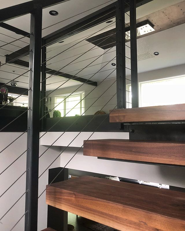Steel Throughout 🔩 #integrity_construction_inc #contractor #builder #remodeler #renovator #steelstairs #steelrailing #cablerailing #feeneycablerail #steelbeam #steelceiling #steelaccents #walnuttreads #moderndesign #keepcraftalive #minnesota #twincities