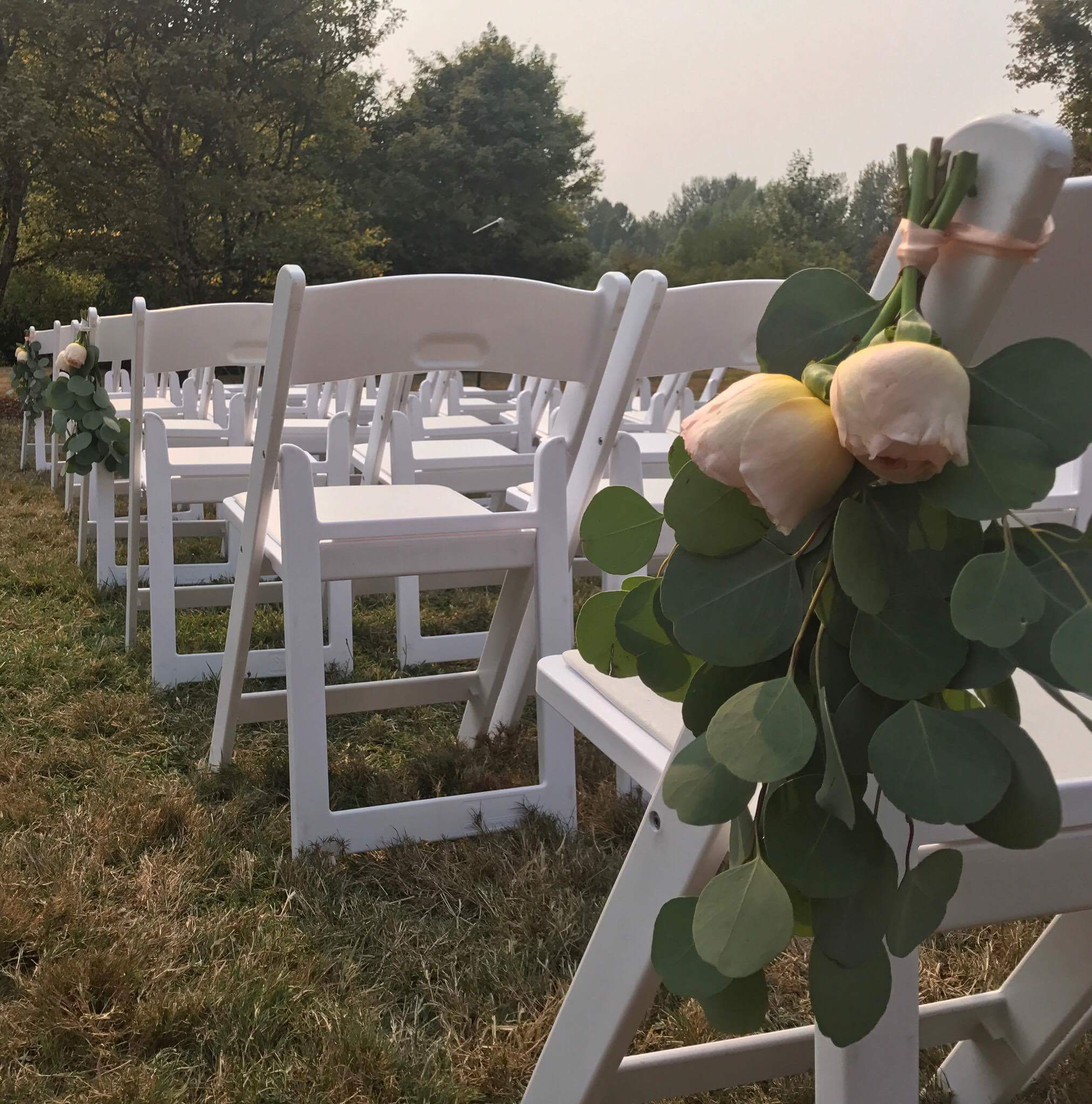 I snapped this shot of the ceremony chair decor. That haze from all the forest fires made for an interesting sky!