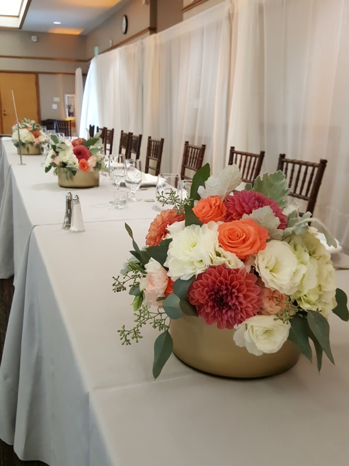 Wedding party table had full gorgeous arrangements down the tables, picture taken by me!